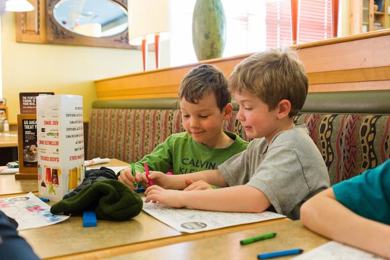 boys draw at restaurant - Family Documentary Photography