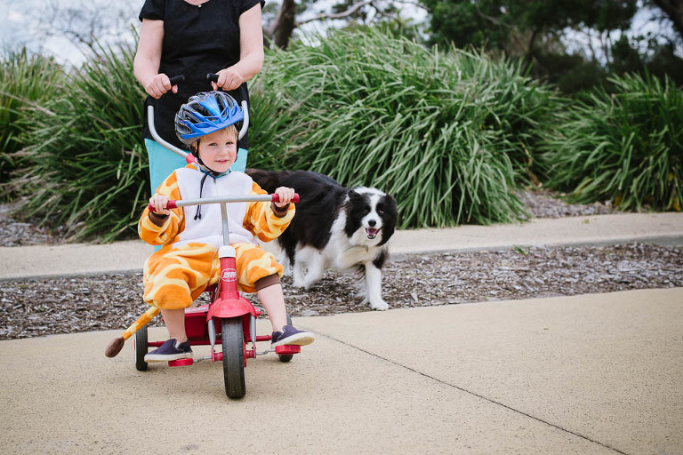 kid on tricycle - Family documentary Photography