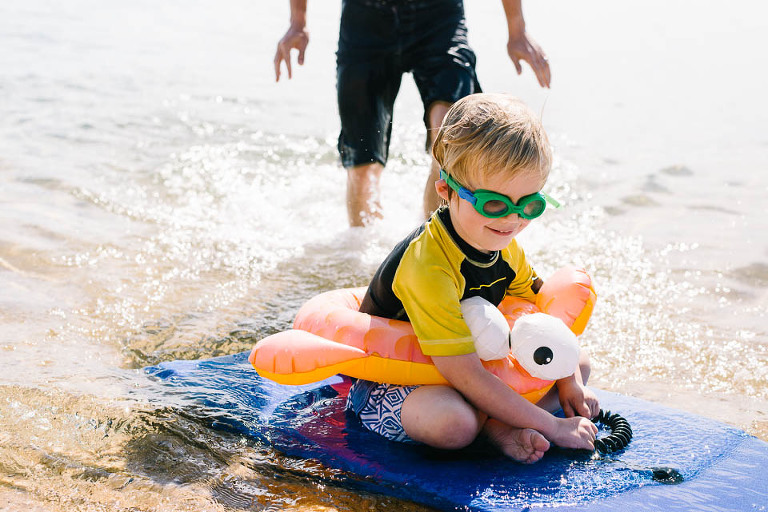 boy with floaties at beach - Family Documentary Photography