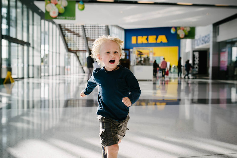 Boy running in IKEA - At the Store, Family Documentary Photography