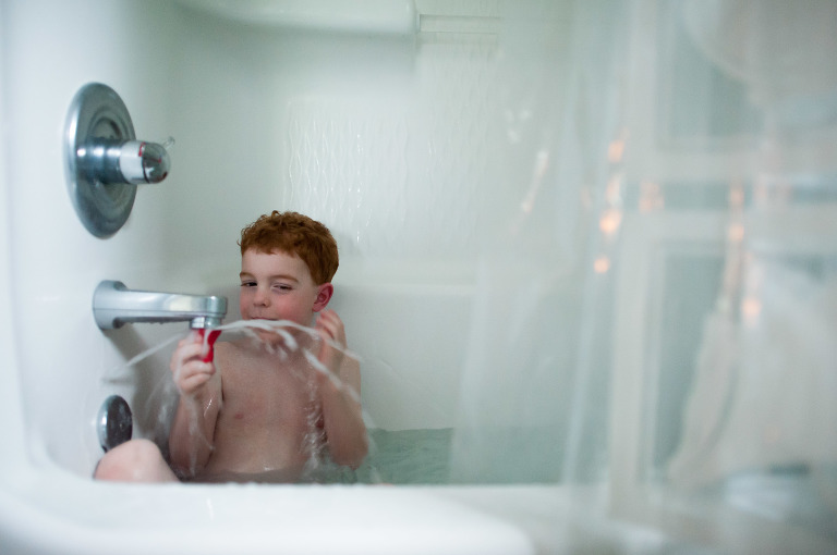 Boy in shower - Family Documentary Photography