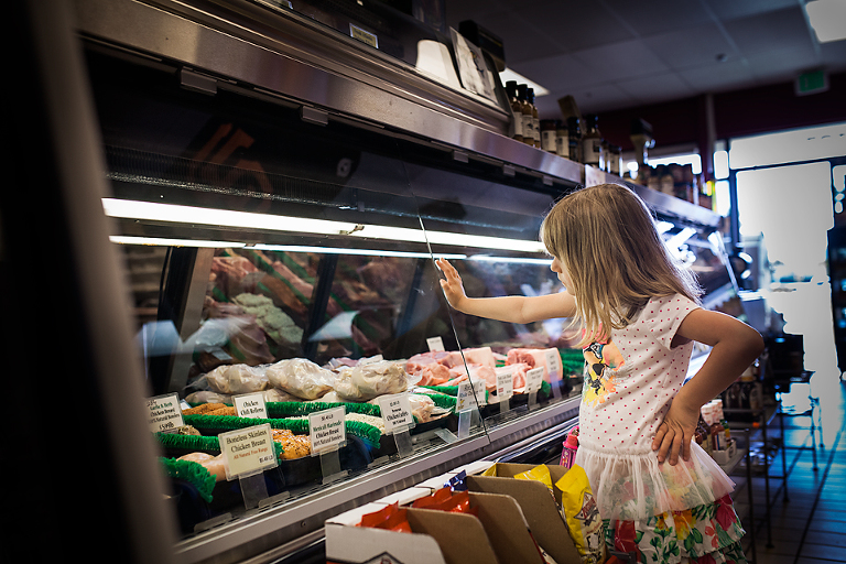 Girl at deli case - At the Store, Family Documentary Photography