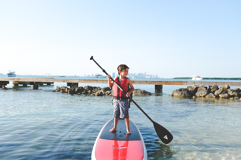boy on paddleboard - Family Documentary Photography