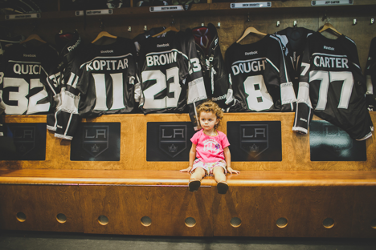 Girl sits on locker room bench - Family Documentary Photography
