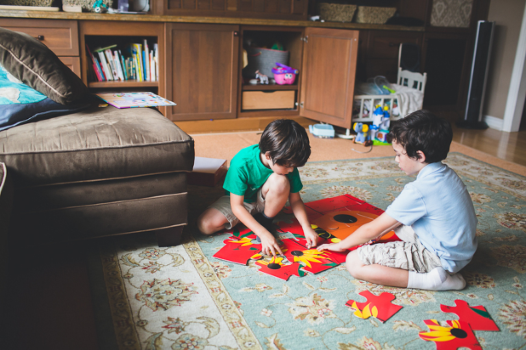boys making a puzzle in family room - Family Documentary Photography
