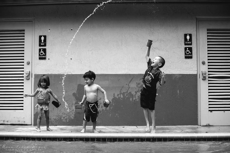 kids playing with water near pool - Outside - Documentary Family Photography