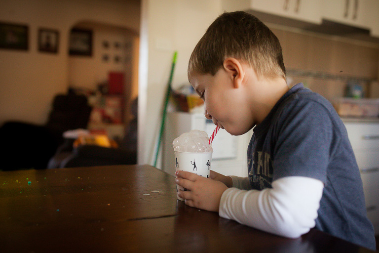 kid blowing bubbles in milk - Family Documentary Photography