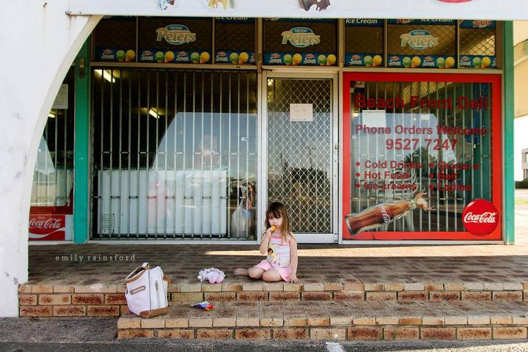 girl on store steps with popsicle - Outside - Documentary Family Photography