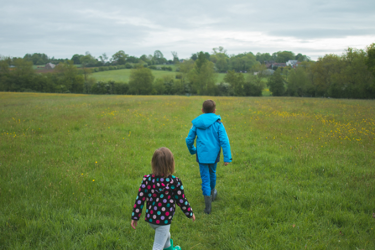 Kids crossing field -Family Documentary Photography