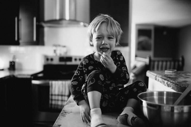 boy crying on kitchen counter - Perfectly Real Artist