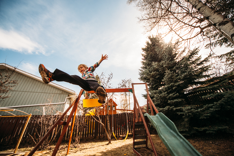 kid jumping off swingset - Perfectly Real Artist