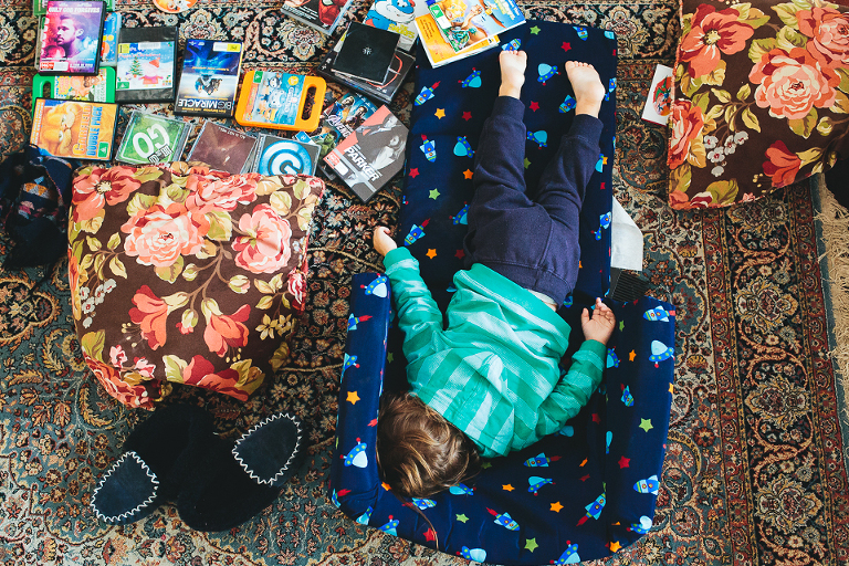 child asleep in a pile of toys - Family Documentary Photography