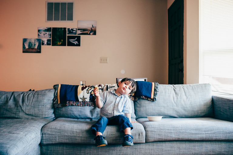 Boy eating apple on couch - Family Documentary Photography