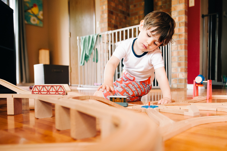 boy playing trains - Family Documentary Photography