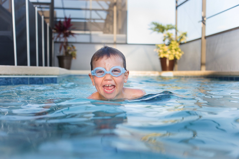 boy in pool - Family Documentary Photography