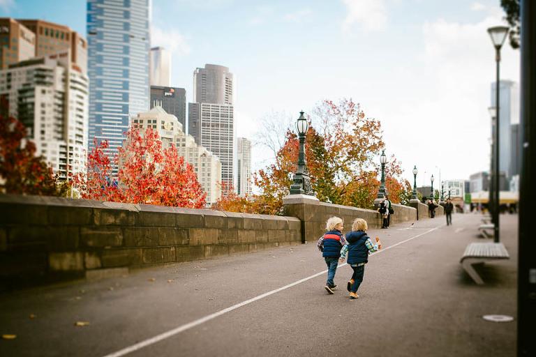 kids walking near city skyline - Family Documentary Photography