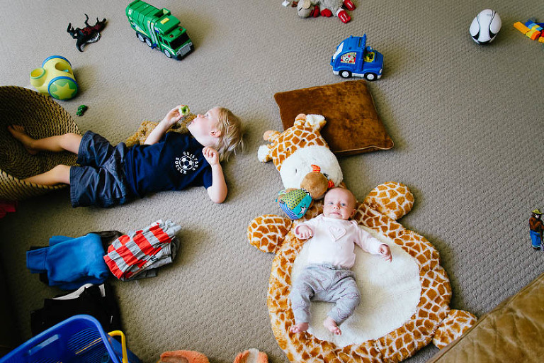kids on floor with toys - Family Documentary Photography
