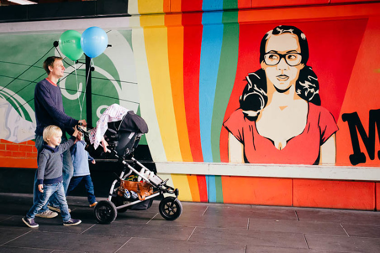 Family near mural - Family Documentary Photography