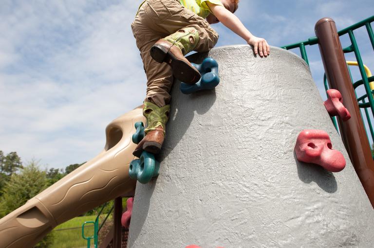 boy on climbing wall - Family Documentary Photography
