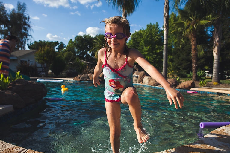 girl in pool with goggles - Family Documentary Photography