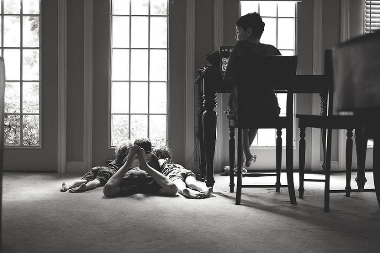 kid on floor at window - Family Documentary Photography