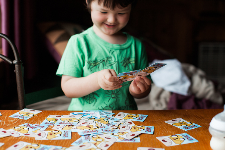 boy playing cards - Family Documentary Photography