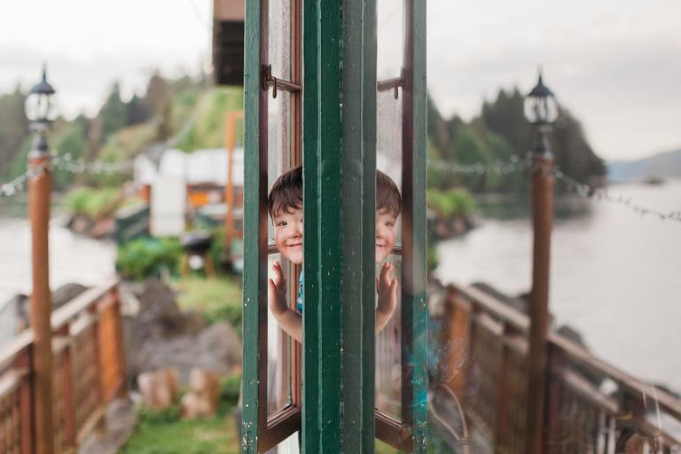 boy peeking out of window - Family Documentary Photography