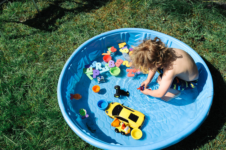 boy in pool with toys - Family Documentary Photography