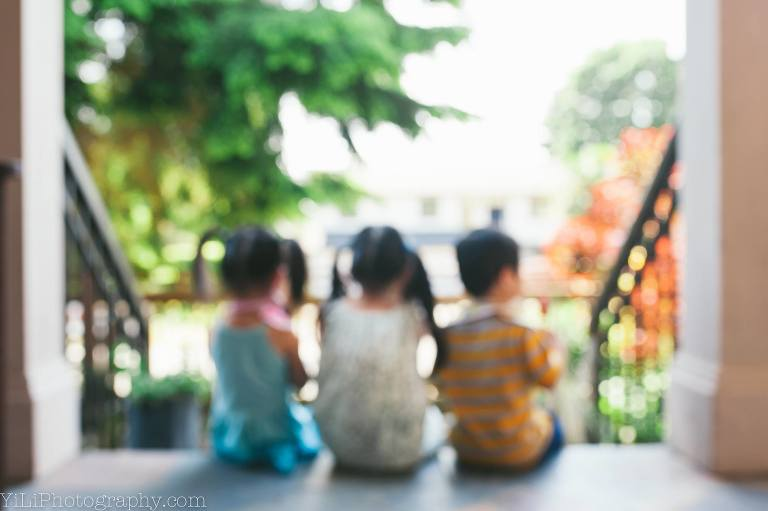 children on porch out of focus