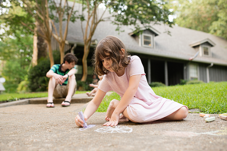 girl with sidewalk chalk -  Family documentary Photography