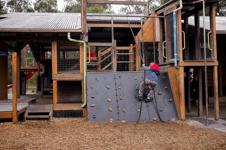 kid on climbing wall - on the go; family documentary photography