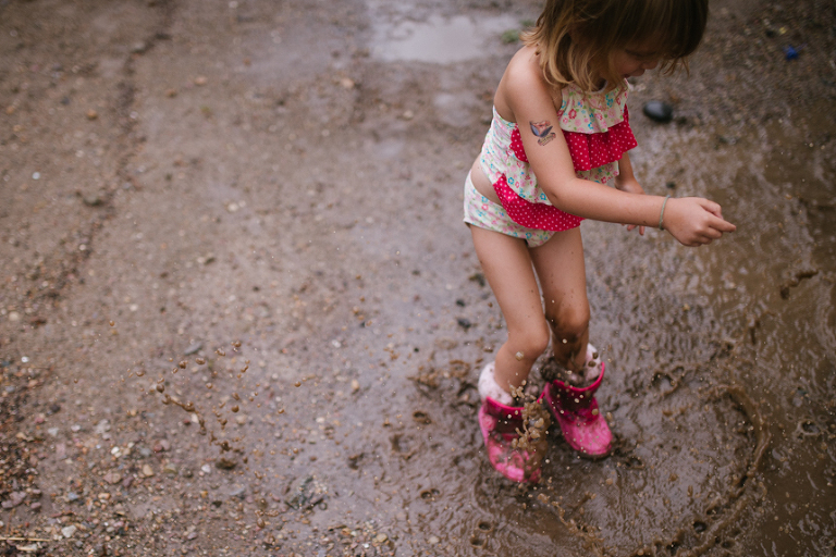 girl stomping in mud -  Family documentary Photography