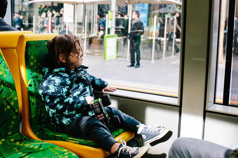 kid in bus seat - on the go; family documentary photography
