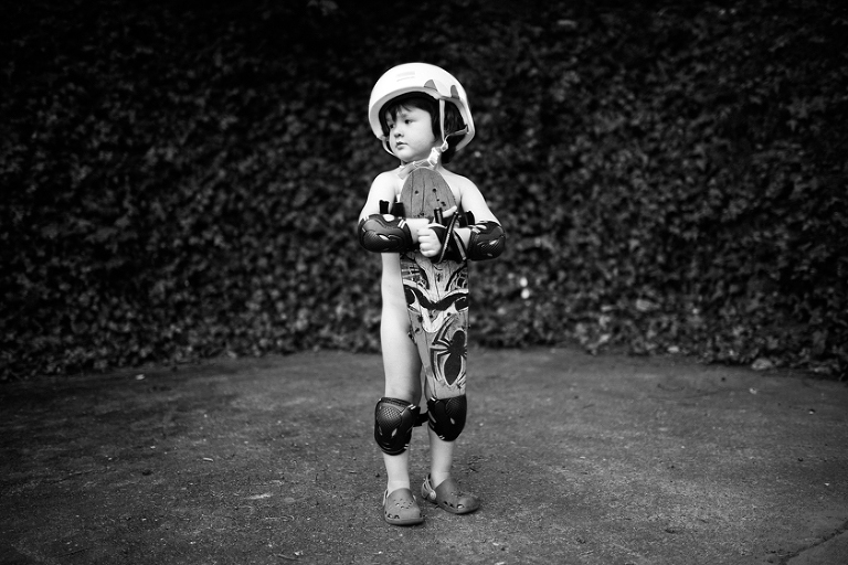 boy with helmet and kneepads