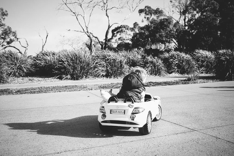 kid in pedal car - on the go; family documentary photography