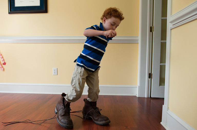 boy in big shoes - on the go; family documentary photography