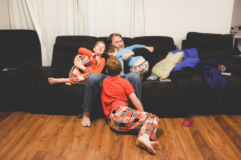 Boys with father on couch - Family Documentary Photography