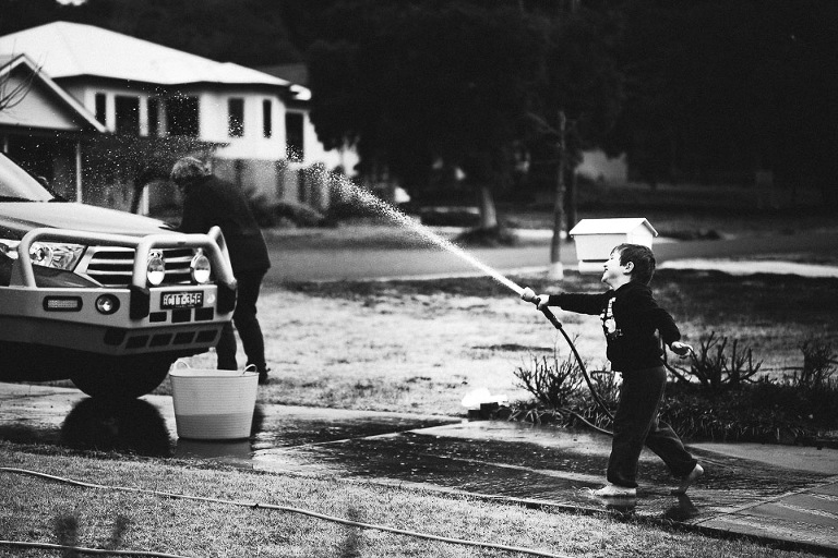 boy with garden hose - family documentary photography