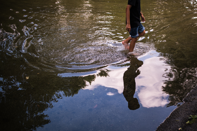 boy in puddle - Family Documentary Photography