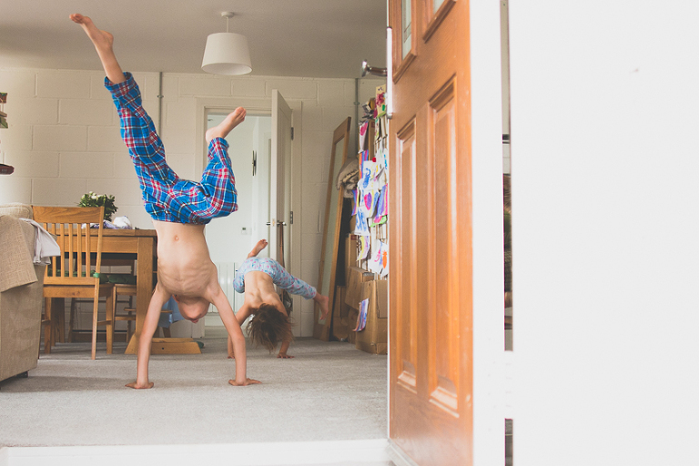kids doing handstands - Family Documentary Photography