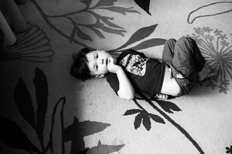 boy on floor -family documentary photography
