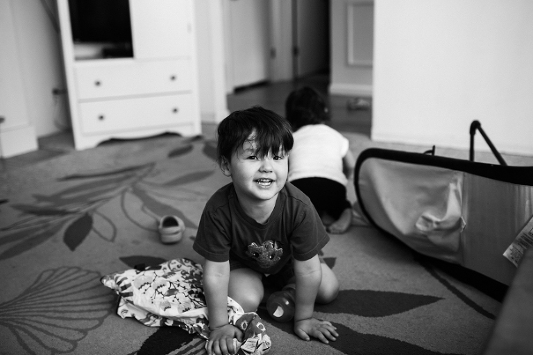 boy playing on floor smiling - Family Documentary Photography