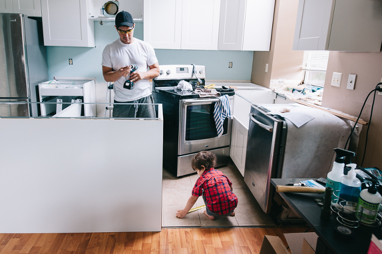 father and little boy remodeling kitchen - Family Documentary Photography