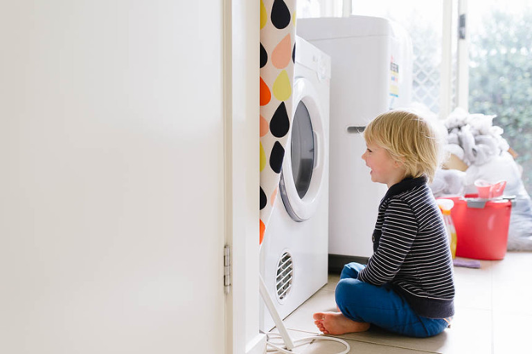 boy watching dryer - Family Documentary Photography