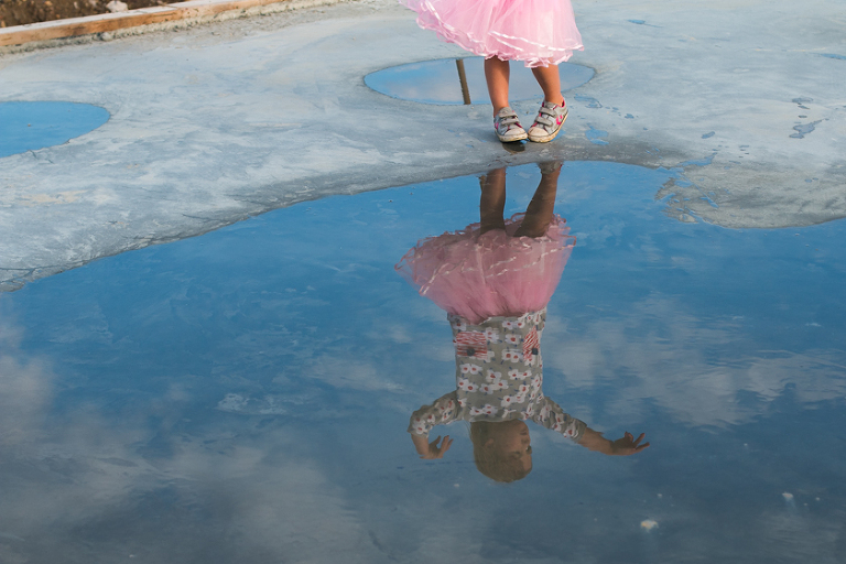 reflection in puddle of girl dancing - Family Documentary Photography