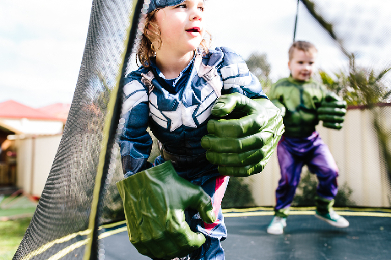 boy in super hero costume with hulk hands - family documentary photography