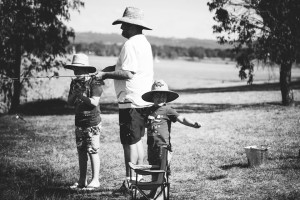 boys fishing with father - at the park