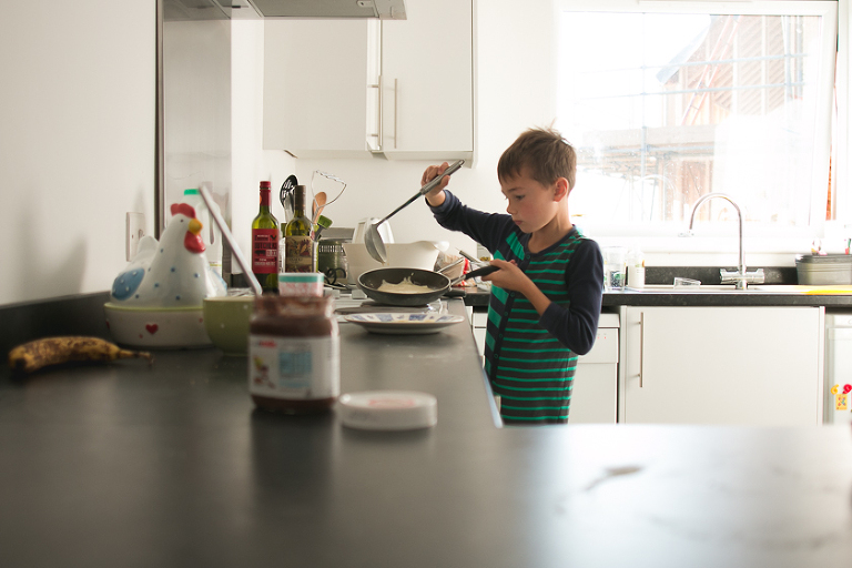 boy making crepes - Family Documentary Photography