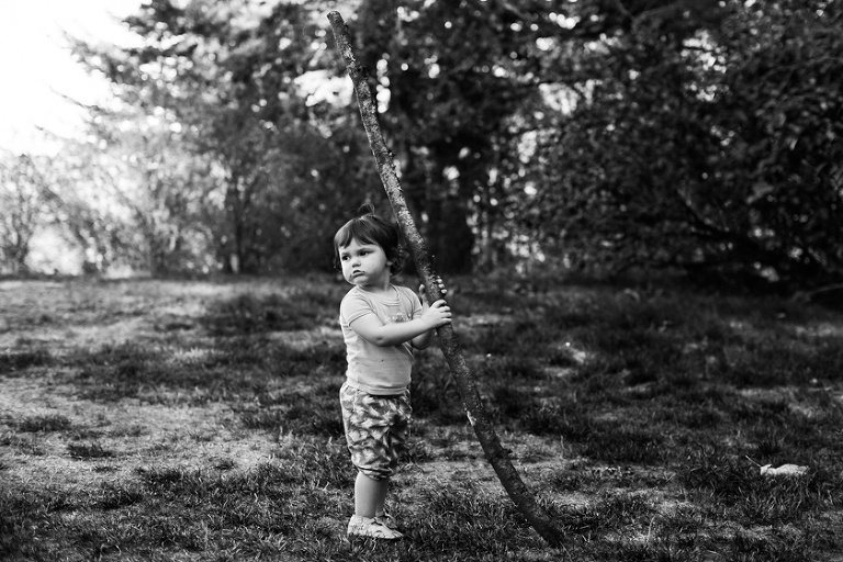 Girl with big stick - Family Documentary Photography