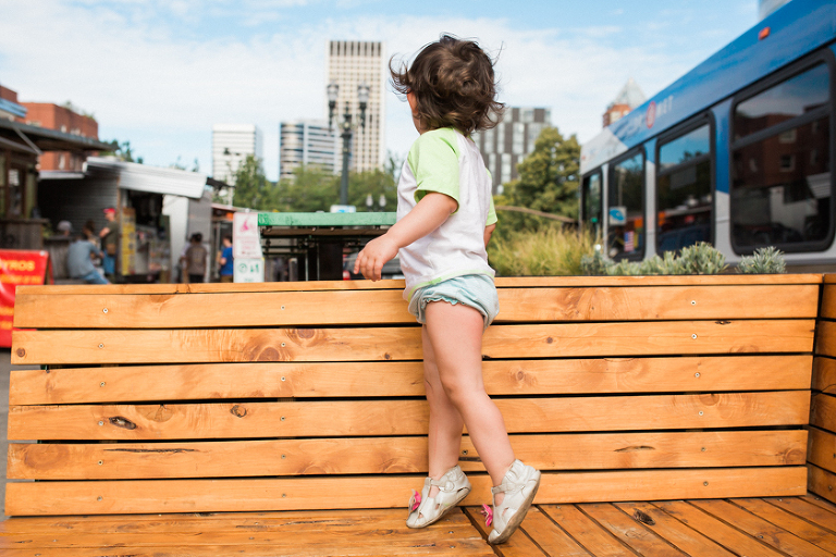 girl tip toeing on park bench - Family Documentary Photography